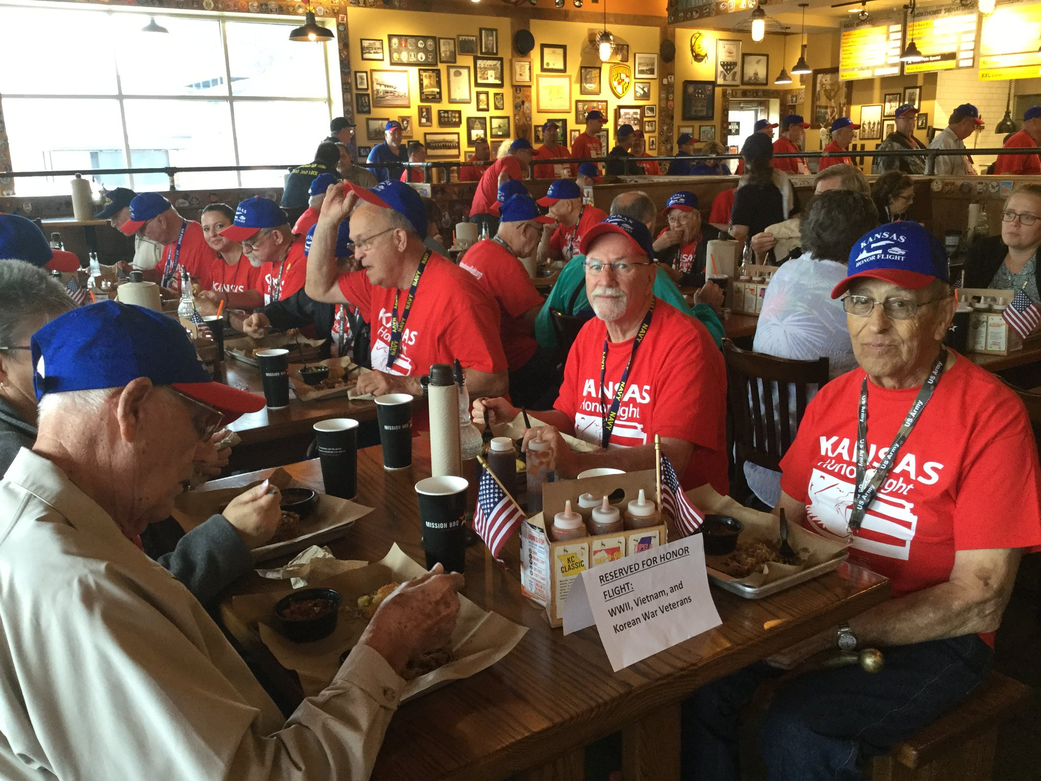 Kansas Honor Flight veterans enjoying lunch.