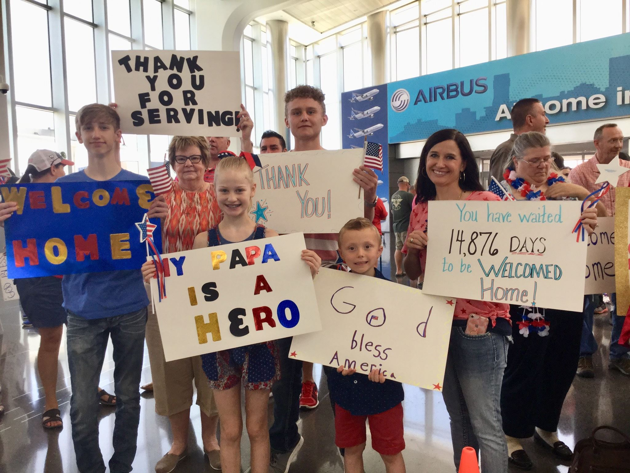 Families of Kansas Honor Flight veterans during a Heroes Welcome Home ceremony