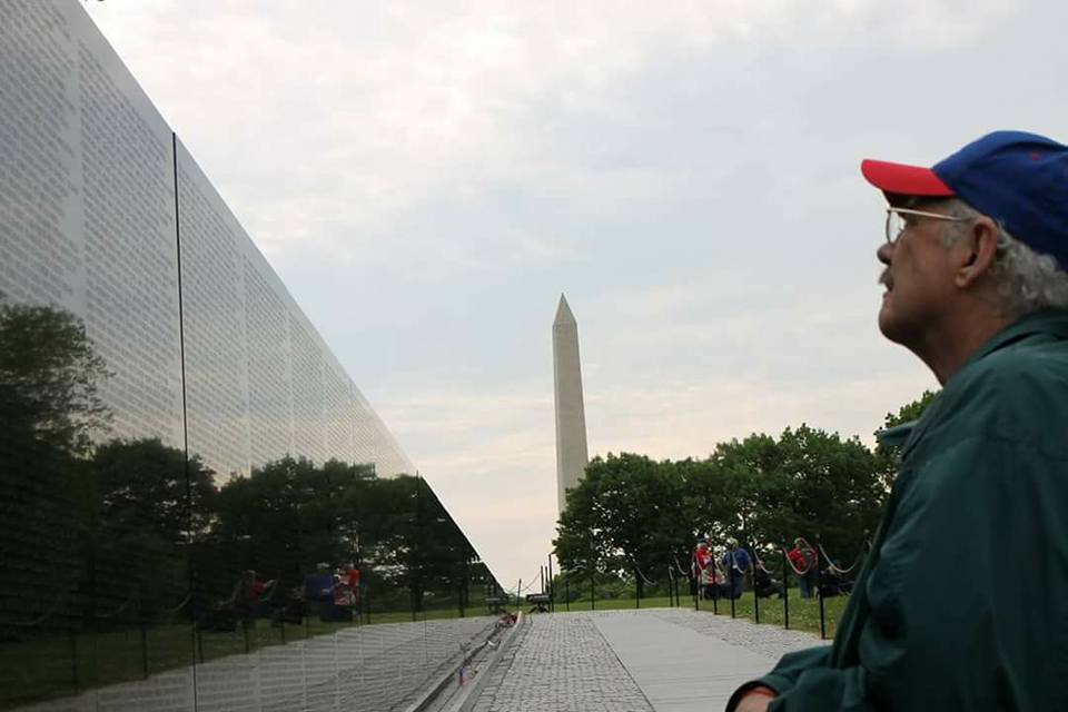 A Kansas Honor Flight veteran at the Vietnam Memorial Wall