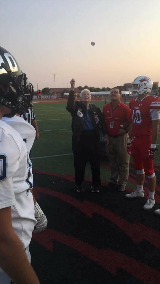 A Veteran calls the coin toss at Maize High School Fundraiser for Kansas Honor Flight
